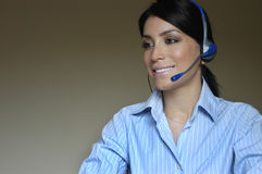 Operator woman in phone. Glad woman operator working talking in phone Stock Photo