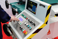 Operator working with control panel. Of cnc turning and milling machine. Selective focus Royalty Free Stock Images