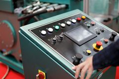 Operator and control panel. Operator working with a control panel of modern metalworking machine. Selective focus Royalty Free Stock Photo