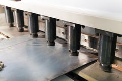 Operator working cut and bending metal sheet by high precision metal sheet bending machine, cnc control metal sheet. Bending machine in factory Stock Image