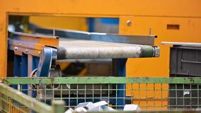 Operator working at Factory conveyor belt. Industrial manufacturing process. Metal stamped pieces production line. Metal