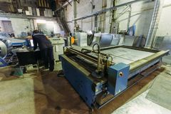 Operator works with plasma cutting machine with program control in metalwork factory royalty free stock photos