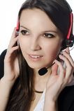 Operator. The young girl talking over the heaset royalty free stock photos