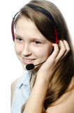 Operator. The young girl talking over the heaset stock photography