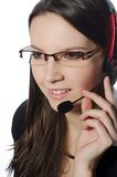 Operator. A young girl talking on the phone with headset Royalty Free Stock Photo