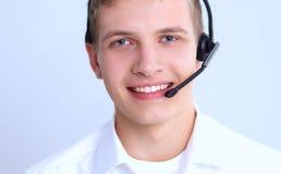 Operatore del servizio clienti con una cuffia avricolare isolata su fondo bianco Fotografie Stock Libere da Diritti