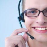Operatore del servizio clienti con una cuffia avricolare isolata su fondo bianco Immagine Stock