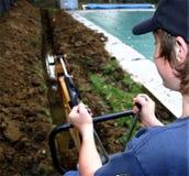 Operatore dell'escavatore a cucchiaia rovescia Fotografia Stock Libera da Diritti