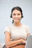 Operatore dell'help-line con il computer portatile Fotografia Stock