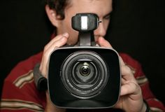 Operatore di Cameraman_camera Immagine Stock