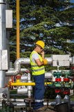 Operatore di produzione del gas e del petrolio Immagini Stock