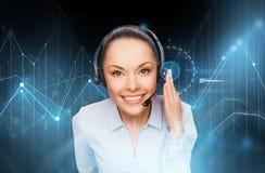 Operatore femminile dell'help-line con la cuffia avricolare immagine stock