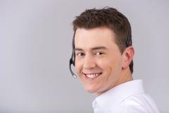Operatore maschio della call center isolato su bianco Fotografia Stock