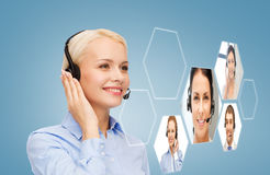 Operatore sorridente dell'help-line della donna Immagine Stock