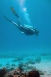 Operatore subacqueo alla parte inferiore Fotografia Stock