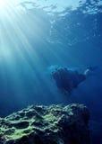 Operatore subacqueo e sunrays Immagini Stock Libere da Diritti