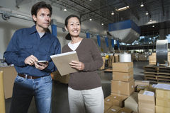 Operators In Distribution Warehouse. Multiethnic men and women in distribution warehouse stock photos