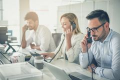 Operators in the office. Teamwork. Operators in the office. Colleagues at call center working stock images
