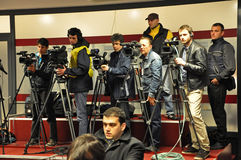 Operators and photographers at a press conference Stock Photography