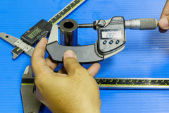 Operators prepare measuring equipmen to inspection mold and die Stock Photos