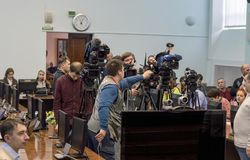 Operators and sound directors set up equipment for Pavel Grudinin`s press conference. Press pool. Russia. Nizhny Novgorod, Russia February 9, 2018: Operators and royalty free stock images