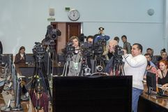 Operators and sound directors set up equipment for Pavel Grudinin`s press conference. Press pool. Russia stock photo