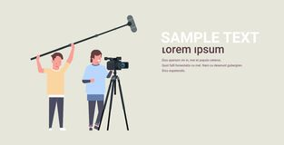 Free Operators Using Video Camera On Tripod Holding Microphone Men Working With Professional Equipment Recording Movie Making Royalty Free Stock Photography - 145527227