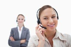 Operatörer med hörlurar med mikrofon Arkivbilder