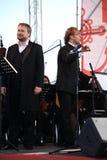 Operazanger Boris pinkhasovich, bariton, Russische operaster en de leider van het symfonieorkest Fabio Mastrangelo Stock Foto