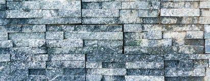 Opgedoken de textuurbakstenen muur van de steentegel Stock Foto
