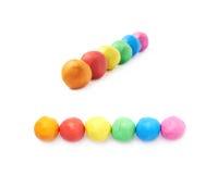 Opgestelde geïsoleerde plasticineballen Stock Foto's