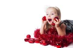 Opgewekt meisje met nieuw jaarspeelgoed Royalty-vrije Stock Afbeelding
