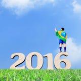 Opgewekte mens met de vlag van Brazilië Royalty-vrije Stock Foto