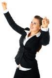 Opgewekte moderne bedrijfsvrouw die van haar succes geniet Stock Foto's