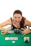 Opgewekte vrouw die bij casino wordt gewonnen royalty-vrije stock afbeelding