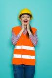 Opgewekte Vrouwelijke Bouwvakker Stock Foto's