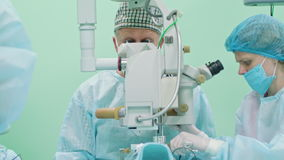 Ophtalmology surgeons within the intervention stock footage