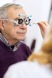 Ophthalmic doctor measure distance of eyes pupil. In consulting room Stock Image