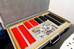 Ophthalmologist box with lenses and glasses royalty free stock images