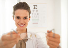 Ophthalmologist doctor woman giving eyeglasses Royalty Free Stock Photo
