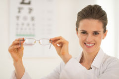 Ophthalmologist doctor woman showing eyeglasses Stock Photos