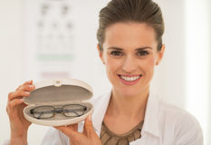 Ophthalmologist doctor woman showing eyeglasses Stock Images