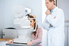 ophthalmologist examining patient vision royalty free stock images
