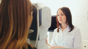 Ophthalmologist in eyes clinic doing diagnostic with vision for patient - high healthcare technology in medicine Royalty Free Stock Images