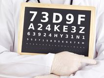 Ophthalmologist holding blackboard with eyesight test Royalty Free Stock Images
