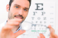 Ophthalmologist make you try new glasses Stock Images