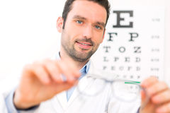 Ophthalmologist make you try new glasses Stock Image