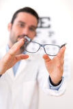 Ophthalmologist make you try new glasses Royalty Free Stock Photo