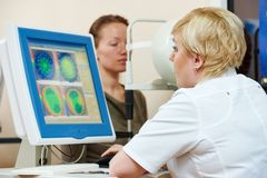 Ophthalmologist or optometrist optician at work Stock Images