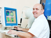 Ophthalmologist or optometrist optician at work Royalty Free Stock Photos